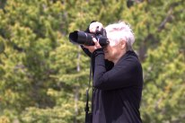 Joan photographing at Engadine meadows